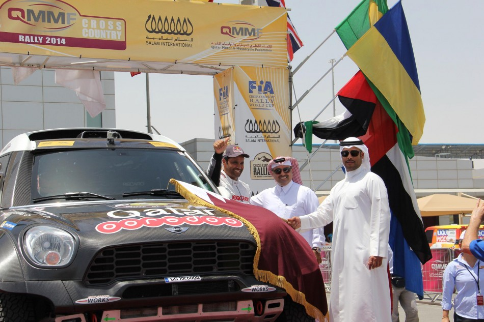 Qatar's Nasser Saleh Al-Attiyah is flagged away from the start of his home event