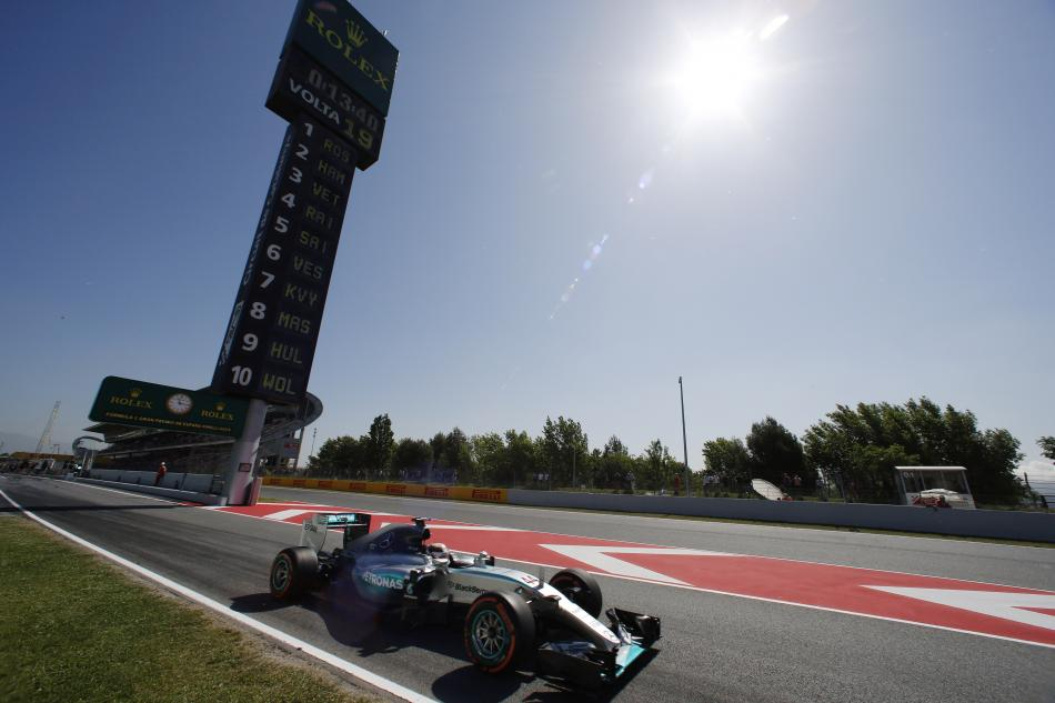 HAMILTON TAKES OVER AT TOP IN SPAIN